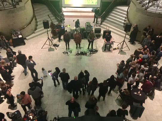 Art lovers gather in the Great Hall to watch a performance