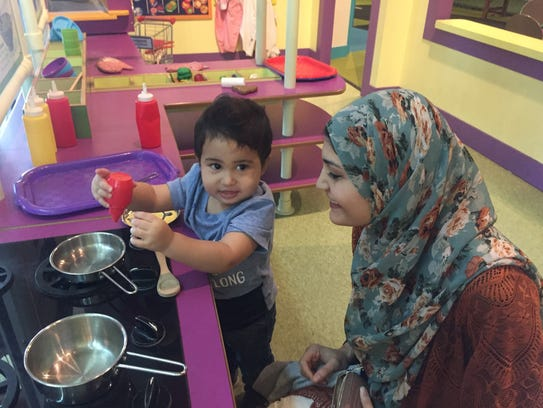 Musa Abdeljaber, 1, plays in Sci-Port's Power of Play