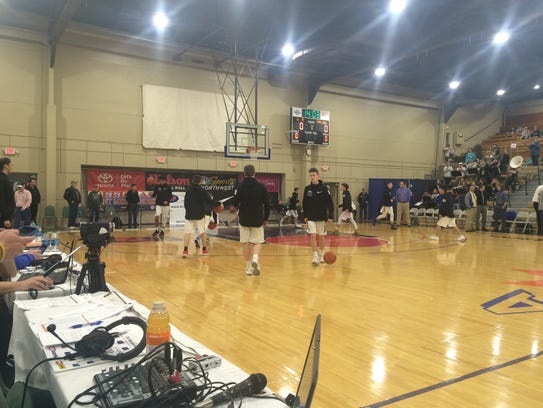 Western Mennonite's boys basketball team warms up before