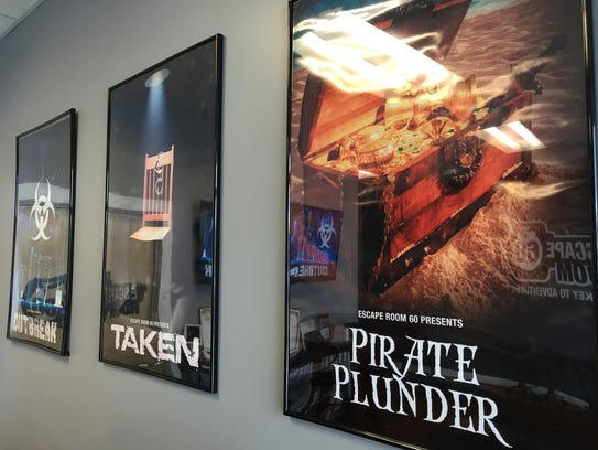 Posters highlight the three rooms at Escape Room 60