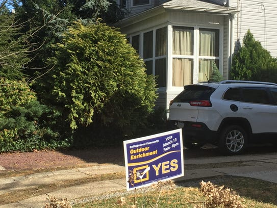 A sign supporting a Collingswood school proposal stands