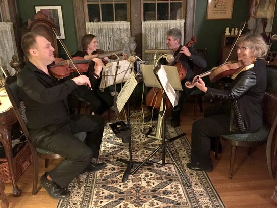 Romanza Music String Quartet with (from left) Mikhail