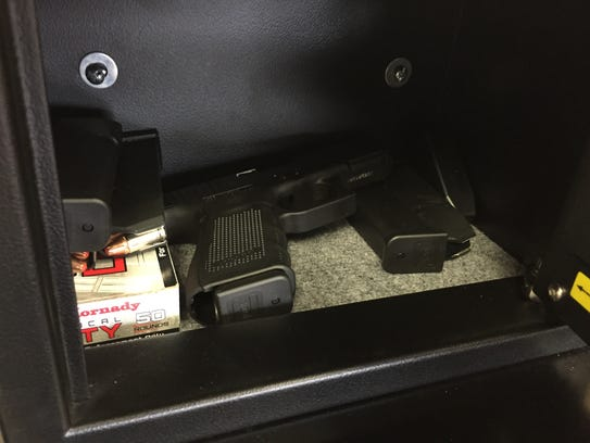 Loaded Glock 19 guns are kept secured in safes that