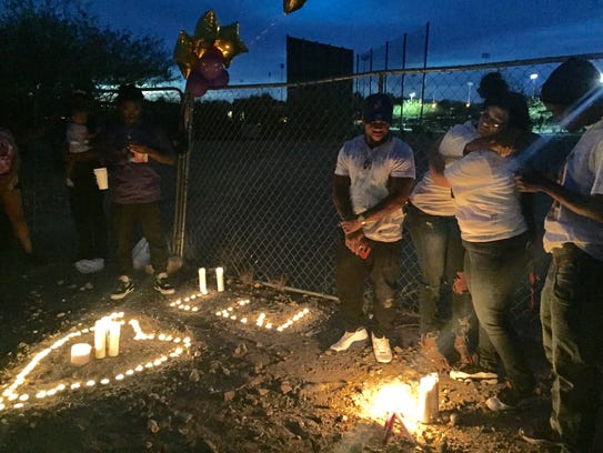 Dozens of friends of Jasmine Dunbar hold a vigil Friday