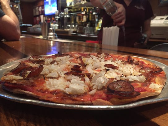 A 10-inch bar pizza, topped with onions and sausage,