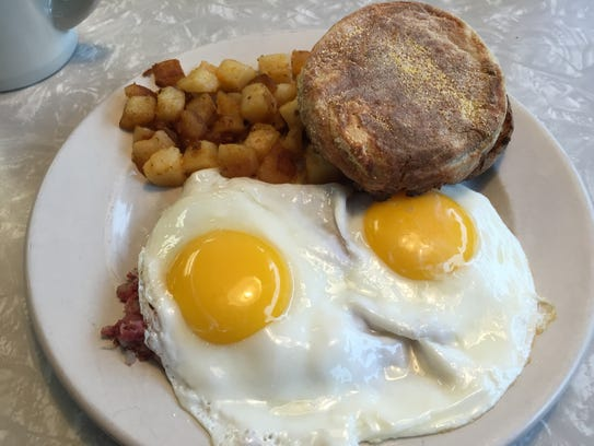 Two eggs sunny side-up with corned beef at Athens Diner