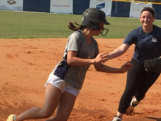 Naples sophomore captain Ashlee Lykins avoids the tag