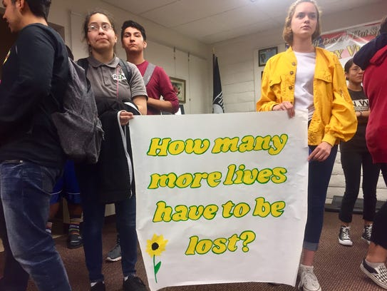 Desert Hot Springs High School students hold a banner