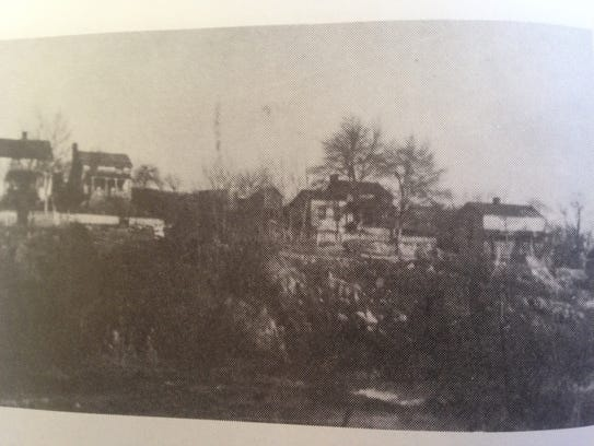 An old photo of Jack's Hill neighborhood shows the