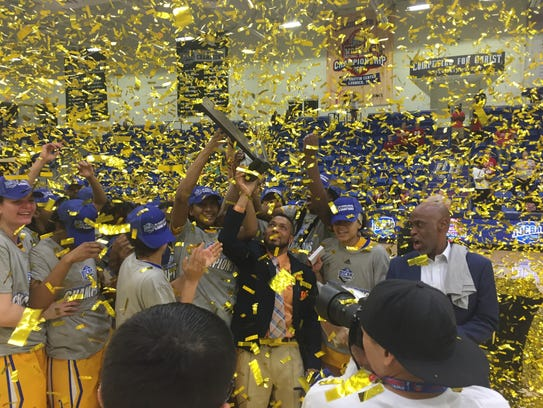 The TCC women's basketball team celebrates its national