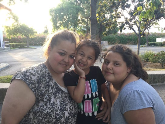Alejandra Mejia and two of her children, Nicole,6,