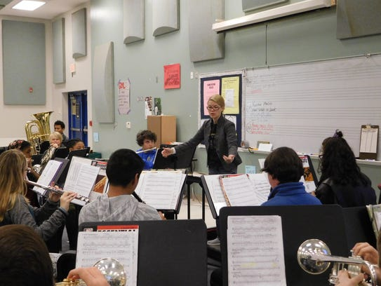 Barbie Townsend leads her band students and asks them