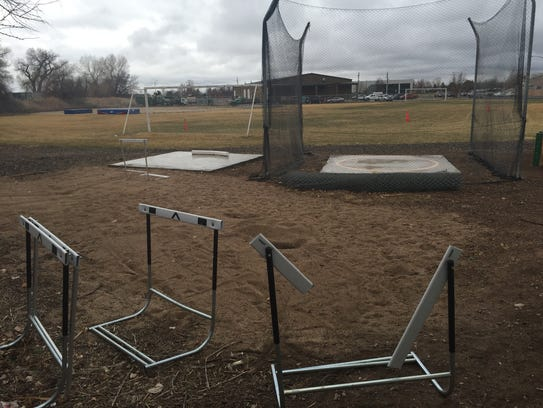 A broken hurdle sits behind the throwing area and soccer
