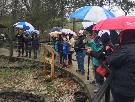 Visitors at Smallin Cave watch the ceremonial dedication