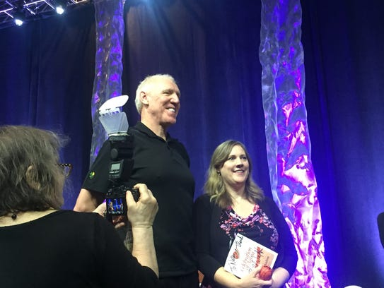 Bill Walton poses with a fan at the Lifespan's 22nd