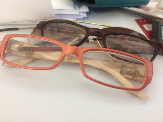 Two pairs of glasses and one pair of sunglasses at