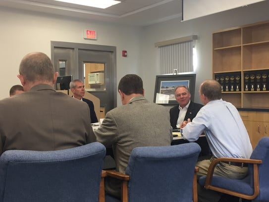 Sen. Tim Kaine leads a roundtable discussion about