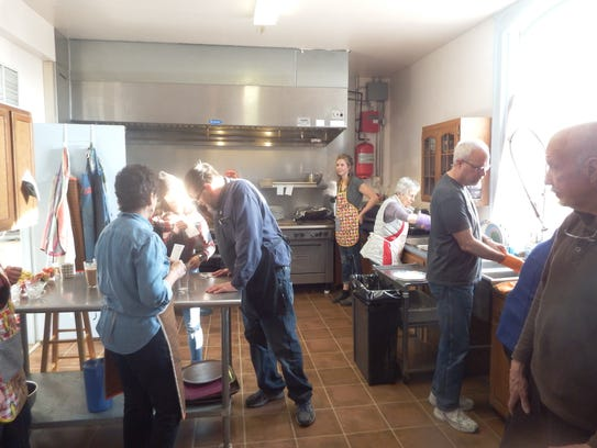 A full kitchen works to feed dozens of people for free