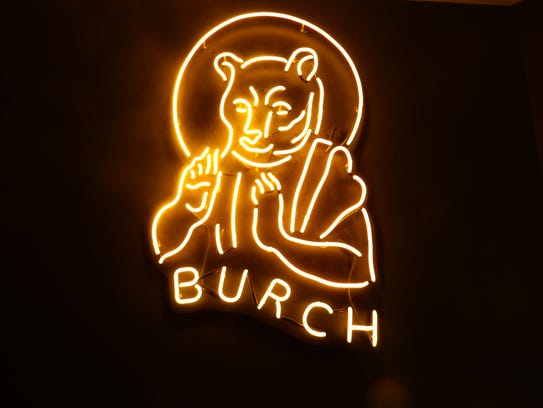 A custom-made yellow neon sign for St. Burch Tavern's