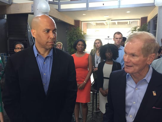 Sen. Corey Booker, D-New Jersey (l) and Sen. Bill Nelson