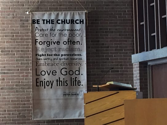 A banner hanging inside the Quentin United Church of