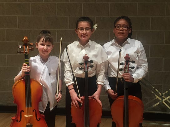 Cellists Simone Ribares (left), from St. Marcus Lutheran