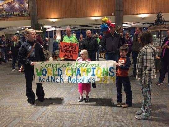 Signs welcome home the RedNek Robotics team.