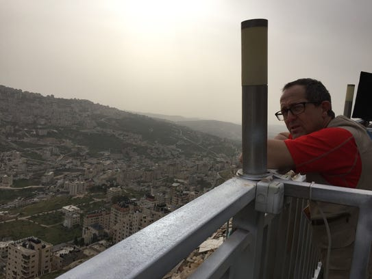 Mark Asplund looks out at Nablus in the West Bank during