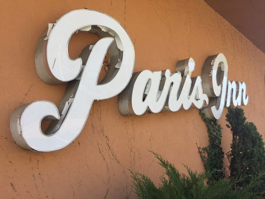 Paris Inn sign.