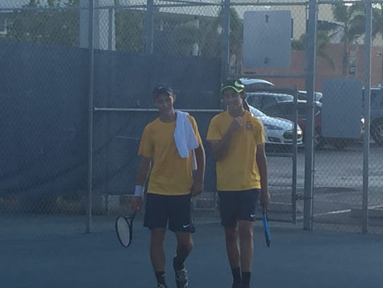 Naples' No. 1 doubles team of Michael Moll, left, and