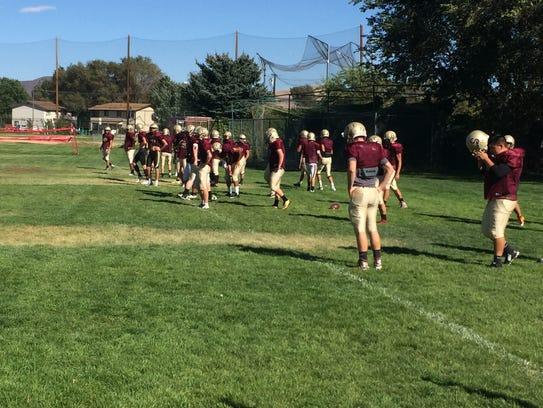 The Sparks High football team practices last season