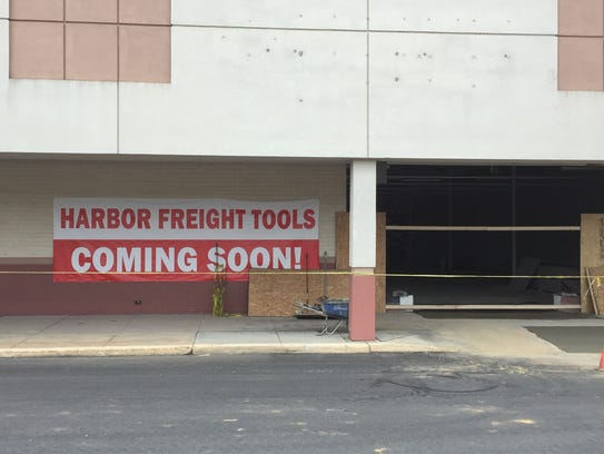 A sign out front of the former location of Sears at