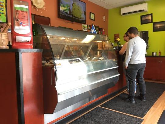 "Customers order a late lunch at Sabor Criollo ""La Casa"