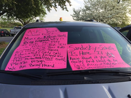 Signs in a vehicle belonging to Arlo Miller, a parent