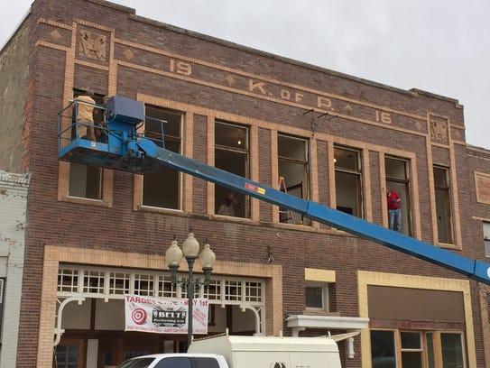 Belt Theater exterior work on the windows