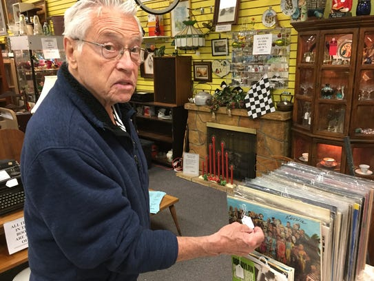 "Mike Gaylord checks the price on a Beatles album, ""Sgt."