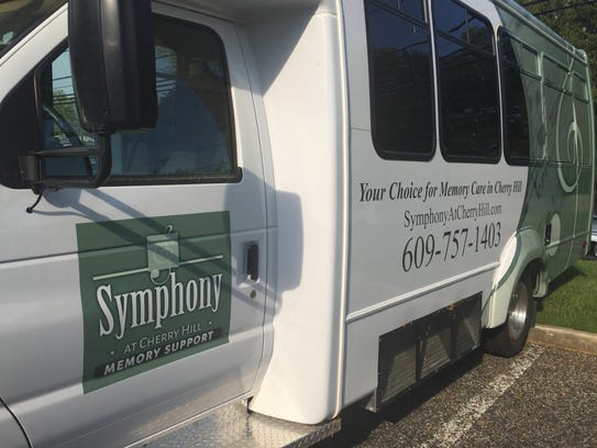 A shuttle bus for future residents is parked near Symphony