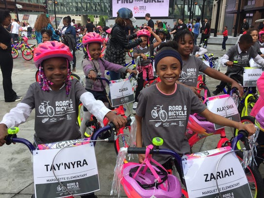 Second-graders from Marquette Elementary Schools were part of the group that received new bikes from the Red Wings and Chevrolet as part of a bike safety training program. Tuesday, May 22, 2018. Helene St. James, DFP.