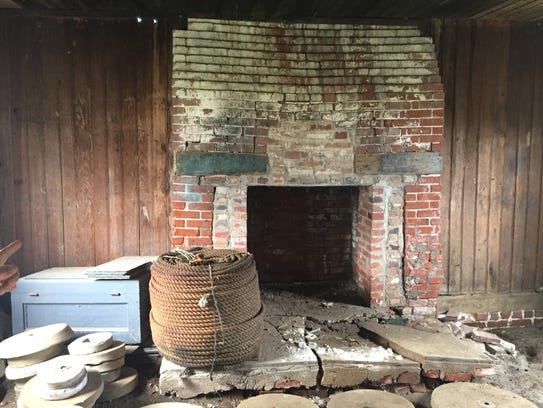 A fireplace inside a 1700s kitchen on the grounds of