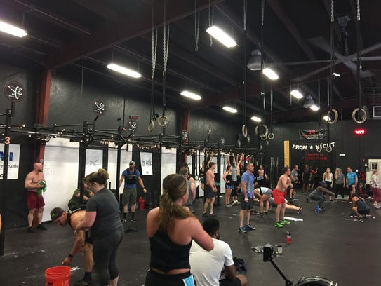 """Crossfit warriors participate in the Memorial Day """"Murph"""" workout at Crossift Reaction in Greenville on Monday."""