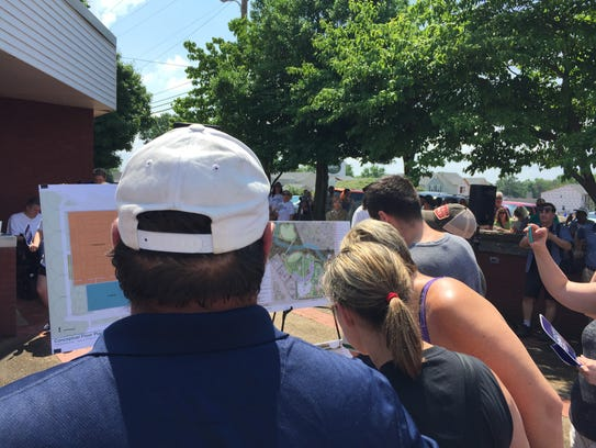 People look at plans to renovate and expand the Old
