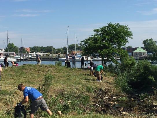 Volunteers pick up trash along Cape Charles Harbor