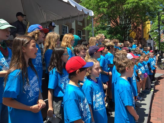 Students from Champlain Elementary School sing in front