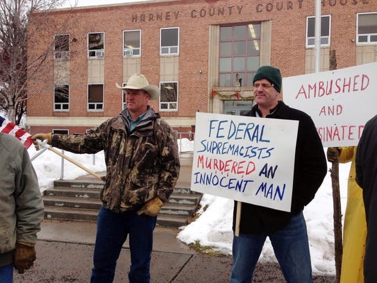 Protesters stand in front of the Harney County Courthouse