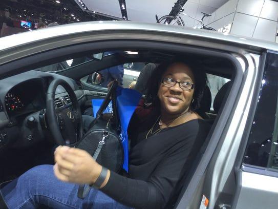 Janell Jackson, 26, of Cincinnati checks out a Lexus