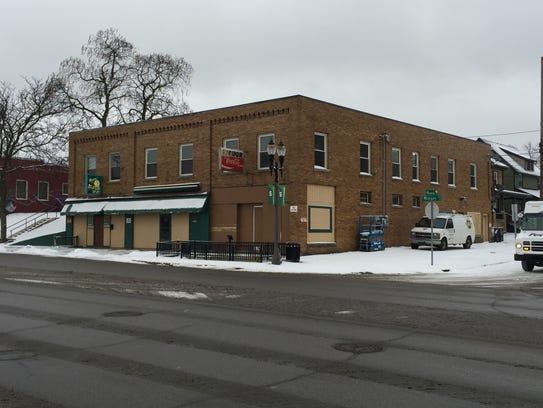 Craftsman Style Apartments Revived Above Lansing Bar