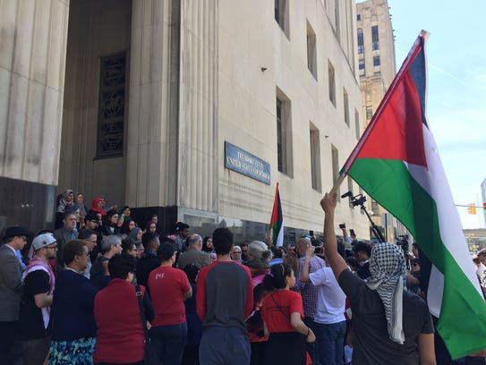Supporters of Rasmieh Odeh, of Chicago, rally in Detroit