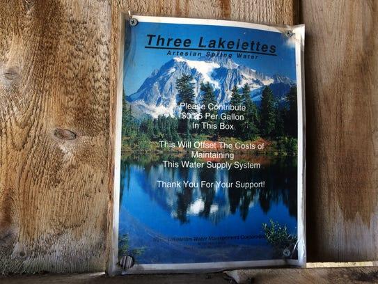 Artesian well fond du lac countys well kept secret a sign inside a wooden shack that contains an artesian sciox Gallery