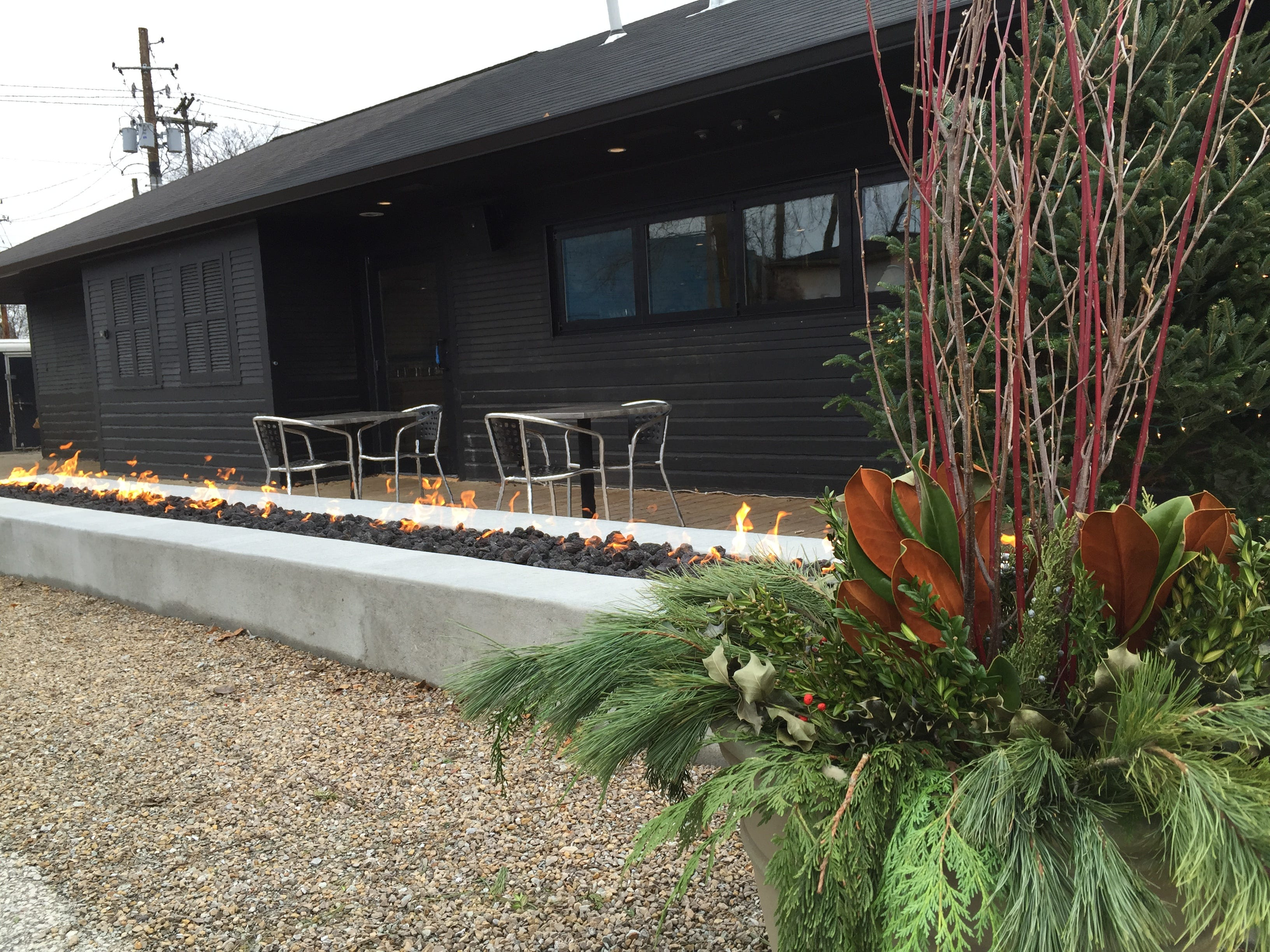 A Fireplace Warms The Patio At Public Greens.