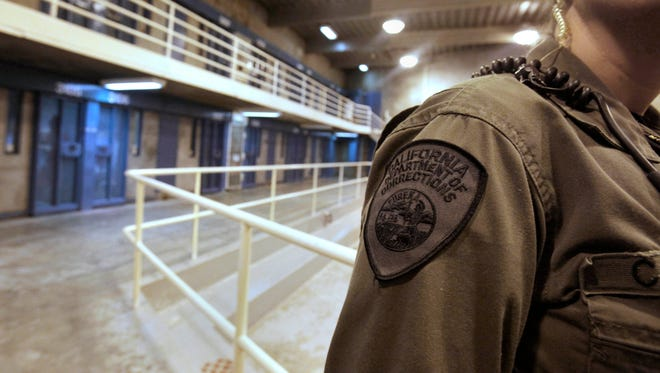 In this Aug. 17, 2011, file photo, a correctional officer is seen in one of the housing units at Pelican Bay State Prison near Crescent City, Calif.